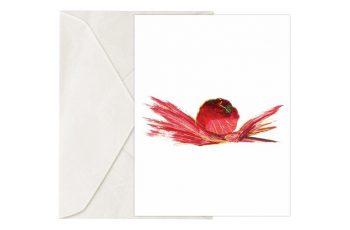 Foto mostra um cartão de Natal e um envelope