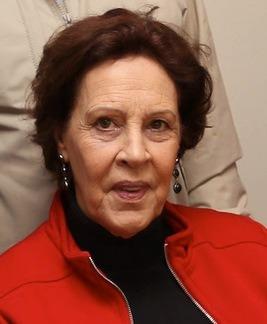 foto de Marta Martelli, uma senhora com cabelos curtos e vermelhos